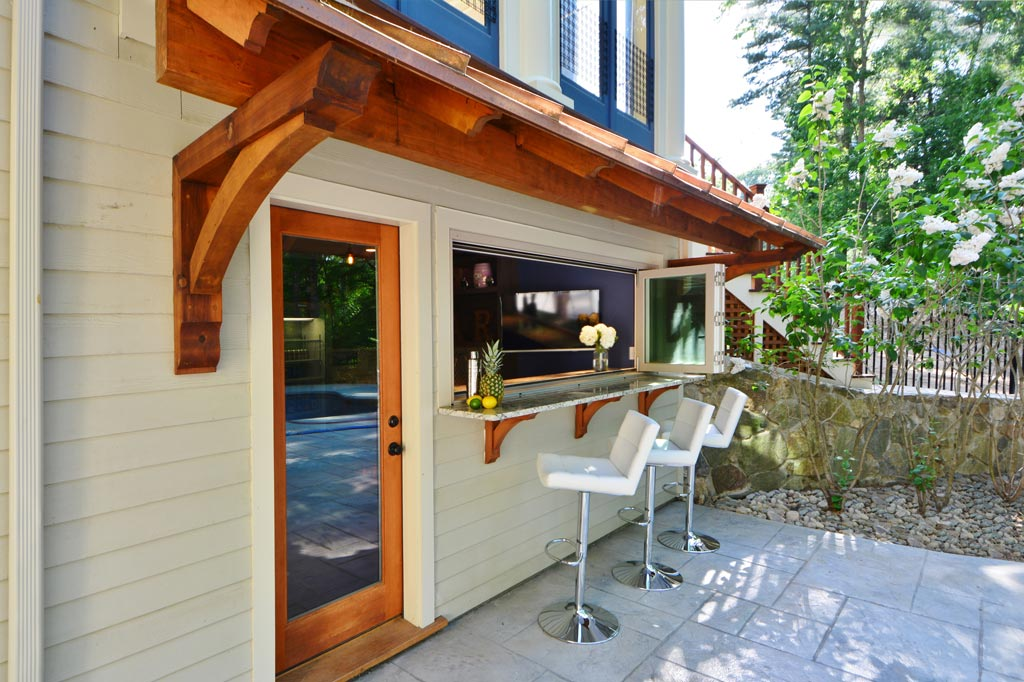 exterior home renovation, bar addition, pergola, pool bar, outdoor entertaining, exterior glass door, retractable glass window, the wiese company