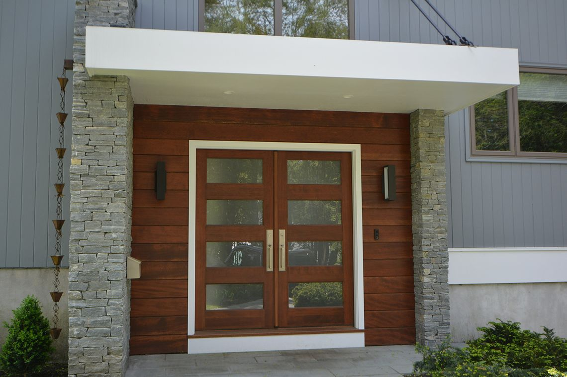 exterior home renovation, front entrance renovation, modern home entrance, modern portico, mixed material home exterior, the wiese company